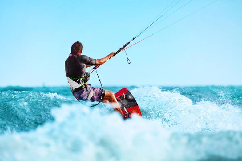 Person without a kiteboarding helmet