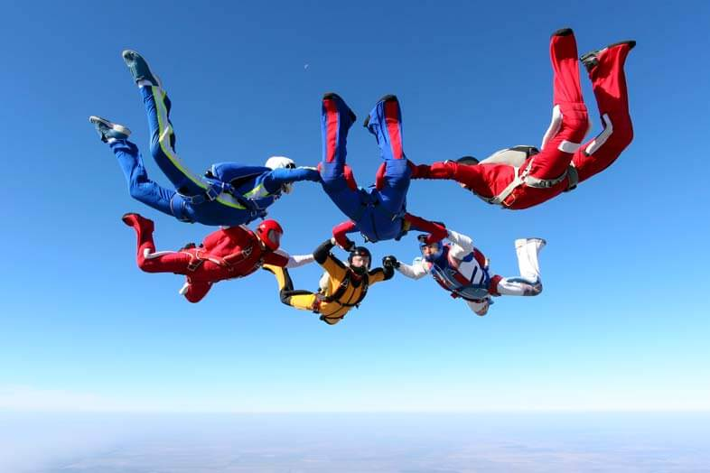 Skydiving group with skydiving helmet