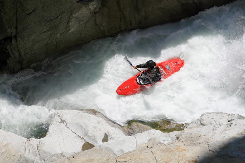 Canoeist with whitewater helmets